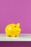 A happy yellow piggy bank Stock Photos