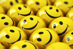 Happy yellow smileys. Macro view of happy yellow smiley face ball icons or buttons with selective focus effect Stock Image
