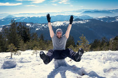 Happy yong hiker on the top of the mountain Royalty Free Stock Photos