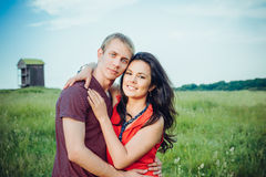 Happy young adult couple in love on the field. Portraits of happy young adult couple in love on the field Royalty Free Stock Images