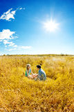 Happy young adult couple in love on the field. Two,  man and wom Royalty Free Stock Photos