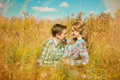 Happy young adult couple in love on the field. Two,  man and wom Stock Photo