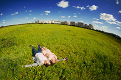 Happy young adult couple in love on the field. Two,  man and wom Stock Photos