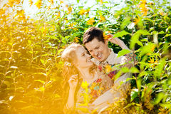 Happy young adult couple in love on the field. Two,  man and wom Royalty Free Stock Photography