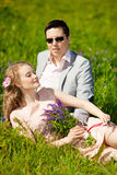 Happy young adult couple in love on the field. Two,  man and wom Stock Images