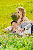Happy young adult couple in love on the field. Two, man and wom. Happy young adult couple in love on the field. Two, men and women smiling and resting on the stock photo