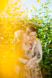 Happy young adult couple in love on the field. Two, man and wom. Happy young adult couple in love on the field. Two, men and women smiling and resting on the royalty free stock photos
