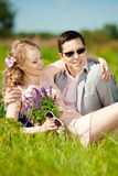 Happy young adult couple in love on the field. Two,  man and wom Royalty Free Stock Images
