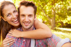 Happy young adult couple relaxing in the countryside, portrait stock photos