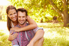 Happy young adult couple relaxing in the countryside, portrait royalty free stock photos