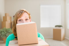 Happy Young Adult Woman Holding Moving Boxes In Empty Room In A Stock Image