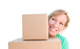 Happy Young Adult Woman Holding Moving Boxes Isolated On A White Stock Photography