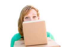 Happy Young Adult Woman Holding Moving Boxes Isolated On A White Royalty Free Stock Image