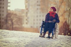 Happy young adult woman on wheelchair Stock Photo