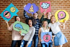 Happy young adults holding thought bubbles. With pop art fashion icons youth culture concept stock images