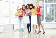 Happy young adults with shopping bags Stock Photo
