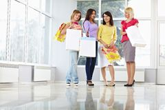 Happy young adults with shopping bags Stock Image