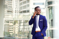 Happy young african american businessman with cell phone Royalty Free Stock Images