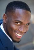 Happy young african american businessman smiling Stock Photos