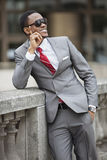 Happy young African American businessman wearing sunglasses Royalty Free Stock Photography