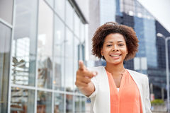 Happy young african american businesswoman in city Royalty Free Stock Images