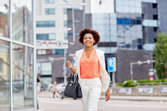 Happy young african american businesswoman in city Stock Photography