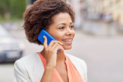 Happy young african american businesswoman in city Royalty Free Stock Photos