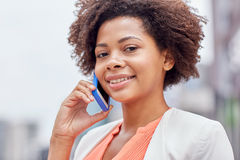 Happy young african american businesswoman in city Stock Image