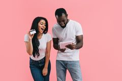 happy young african american couple doing online shopping on digital tablet with credit card stock photos