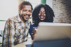 Happy young african american couple having online video chat together via touch tablet at the morning in living room Royalty Free Stock Photography