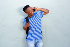 Happy young african american male student talking on mobile phone royalty free stock photography