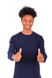 Happy young african american man making thumbs up gesture isolat Royalty Free Stock Images