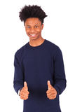 Happy young african american man making thumbs up gesture isolat Royalty Free Stock Image