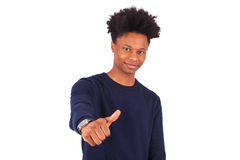 Happy young african american man making thumbs up gesture isolat Royalty Free Stock Photo