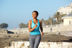 Happy young african american woman enjoying run outdoors Royalty Free Stock Photos