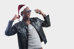 Young african man with Cell Phone at christmas time royalty free stock photo