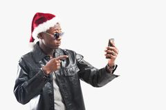 Young african man with Cell Phone at christmas time royalty free stock images