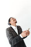 Happy young african man chatting by phone. Picture of happy young african man isolated over white background. Looking aside chatting by phone stock photos