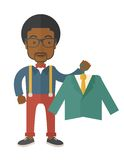 Happy young african man chooses a perfect clothe. A happy young african man chooses a perfect clothe to buy for him to wear. A contemporary style. Vector flat Royalty Free Stock Image