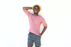Happy young african man in summer wear. Portrait of happy young african man in summer wear standing against white background Stock Image