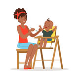 Happy young african mother feeding her baby in highchair, colorful vector Illustration. On a white background Royalty Free Stock Photo