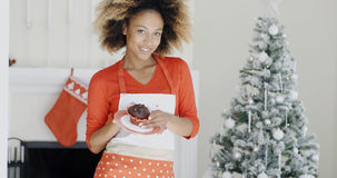 Happy young African woman celebrating Christmas Royalty Free Stock Photography