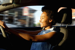 Happy young african woman driving a car Stock Image