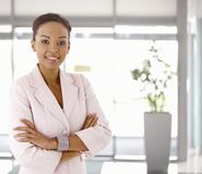 Happy young afro-american woman in office lobby. Portrait of happy young afro-american woman, looking at camera, smiling Royalty Free Stock Photography