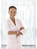 Happy young afro-american woman in office lobby Stock Photos