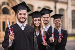 Happy young alumni royalty free stock image