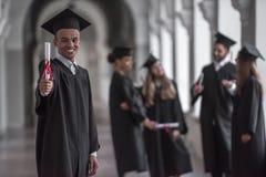 Happy young alumni stock image