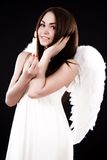 Happy young angel with a candle Stock Photography