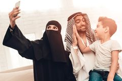 Happy Young Arabian Family Taking Selfie at Home royalty free stock photo