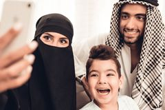 Happy Young Arabian Family Taking Selfie at Home stock image
